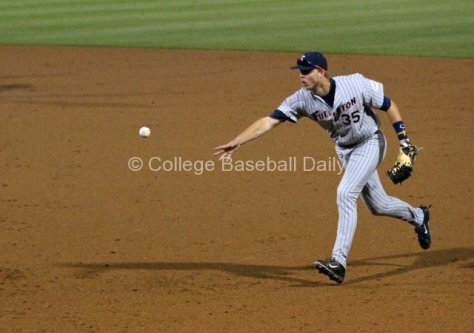 Tanner Pinkston flips a ball to first.