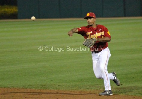 Dante Flores throws to first.