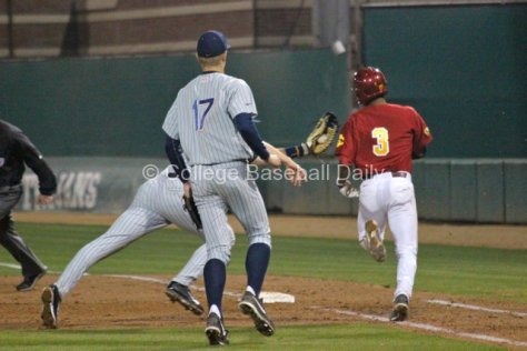 Tanner Pinkston lunges to tag Dante Flores.
