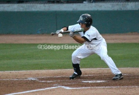 Colby Brenner lays down a bunt.