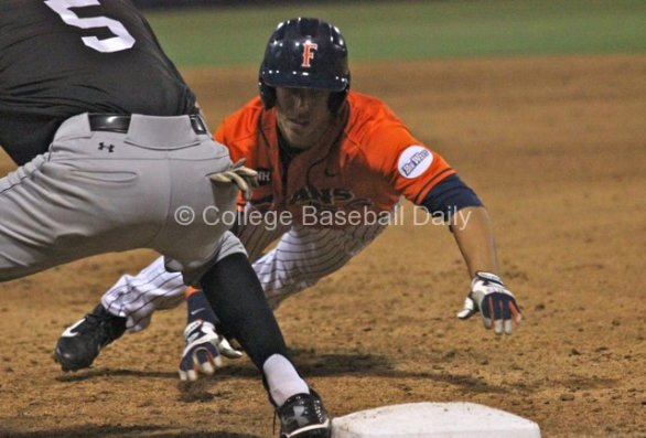 Michael Lorenzen dives back to first.