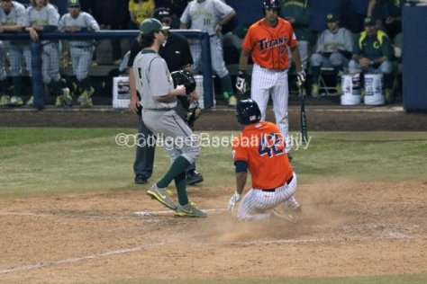 Clay Williamson slides in after a wild pitch.