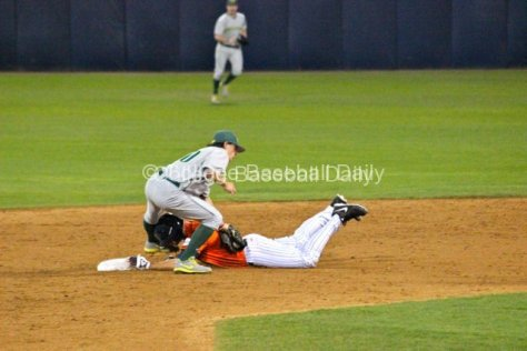 Aaron Payne applies the tag to Matt Chapman.