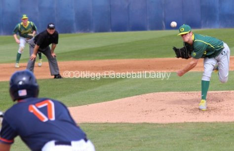 Cole Irvin throws to a bunting Carlos Lopez.