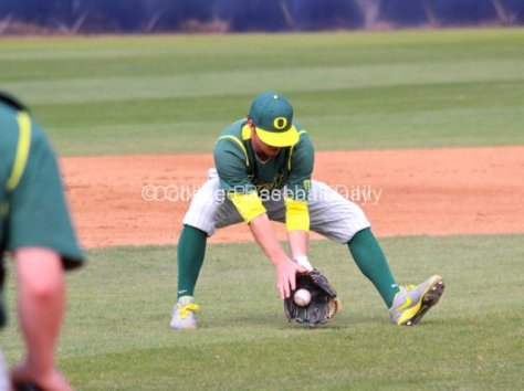 Ryan Hambright charges a sacrifice bunt.