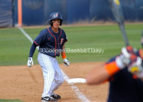 Richy Pedroza leads off third base.