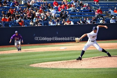 Lefty sidearmer Dave Birosak pitches with a runner on third.