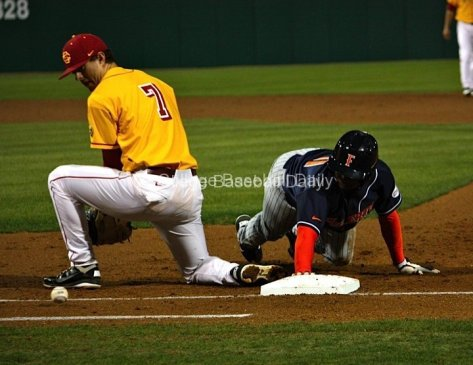 The pickoff throw trickles away from Matt Foat.