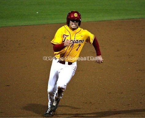 Matt Foat hustles to third base.