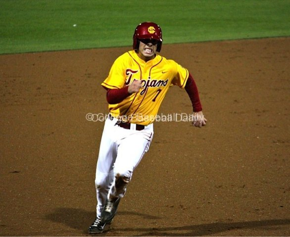 Matt Foat hustles to third base.