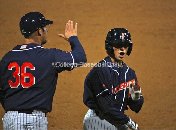 Richy Pedroza throws a high-five after his 2-RBI triple.