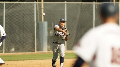 Jonathan Munoz fires across the diamond. (Photo: Mark Alexander)