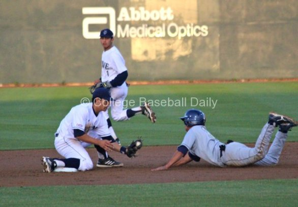 Chris Rabago waits to apply the tag to Adam Young.