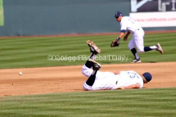 Taylor Sparks watches the ball go through after his diving attempt came up short.