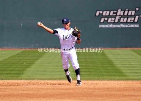 Jeff Stephens throws to first.