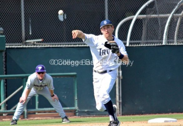 Taylor Sparks charges a ball and throws to first.