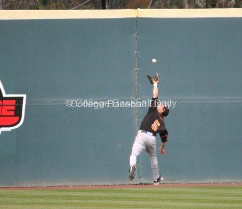 Taylor Murphy runs down a ball at the warning track.