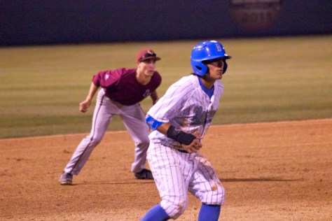 Trent Chatterton leads off third base.