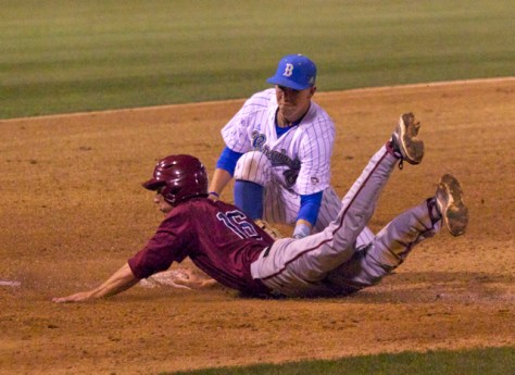 Chris Keck tries to apply the tag.