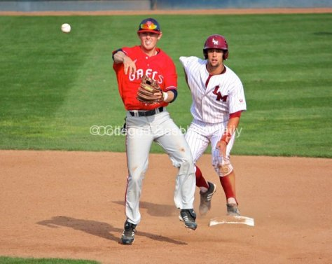 Chris Murphy turns the double play as Colton Plaia watches.