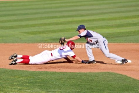 Zach Vincej applies the tag on the pickoff.