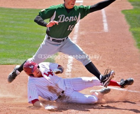 Matt Lowenstein slides in safely after a wild pitch.