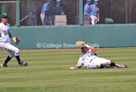 Nick Torres makes a sliding catch.