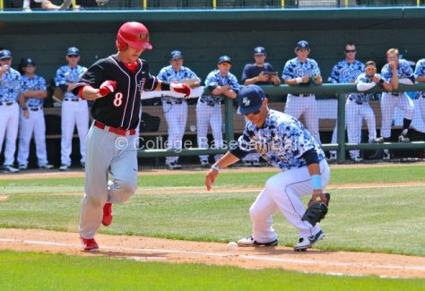 Connor Joe waits to see if Danny Sheehan's bunt will go foul.
