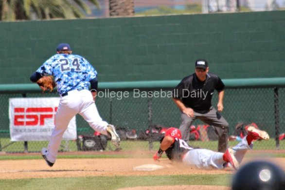 Dylan Covey beats Brad Haynal to first base.