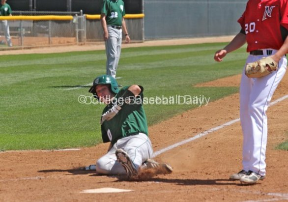 Colby Croft slides in after a wild pitch.
