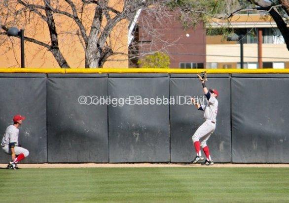 Matt Lowenstein catches a ball just before the wall.