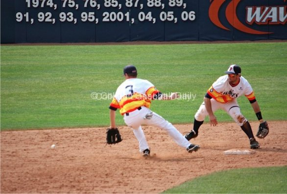 A ball gets away from the Pepperdine middle infield