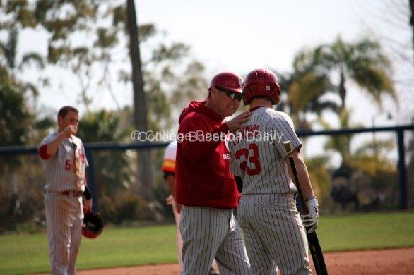 Coach Sunny Golloway gives instruction to Hunter Lockwood