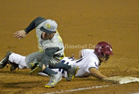 Mitchell Tolman keeps a pickoff from getting away.