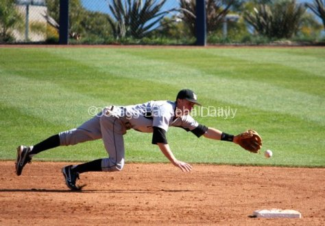 Matt Duffy can't quite reach a grounder up the middle.
