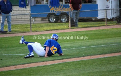 Nick Vilter slips when trying to put on the brakes coming around third.