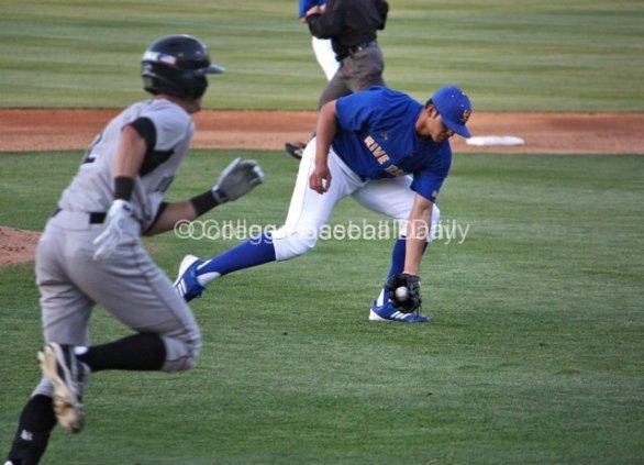 Eddie Orozco fields a bunt attempt.
