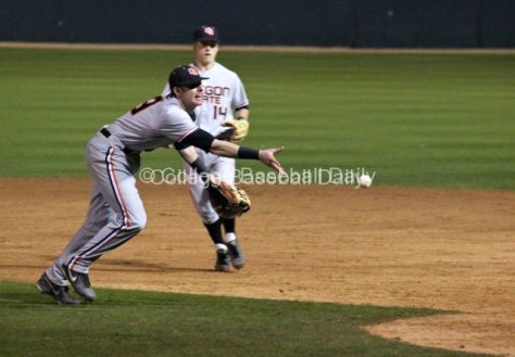 Danny Hayes flips to the pitcher covering first base.