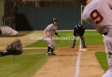 Max Gordon watches as Danny Hayes singles home the winning run.