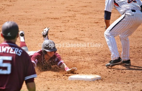 Mikey Reynolds dives into third base.