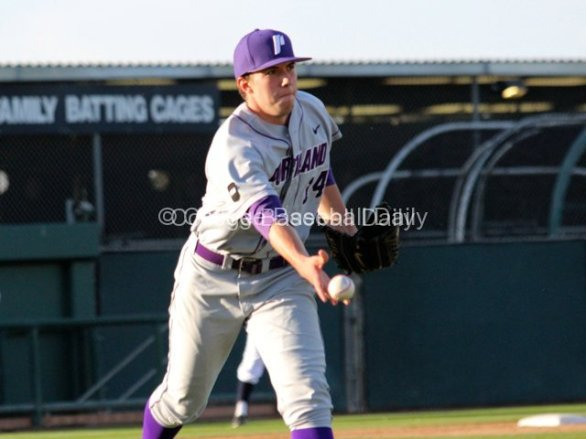 Chad Kjemhus underhands a ball to first.
