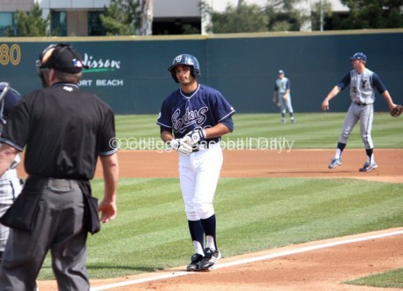 D.J. Crumlich stares down the umpire after he is called out.