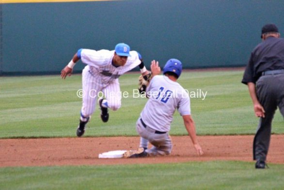 Kevin Williams applies the tag and jumps out of the way.