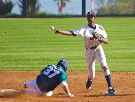 Manny Jefferson turns a double play.