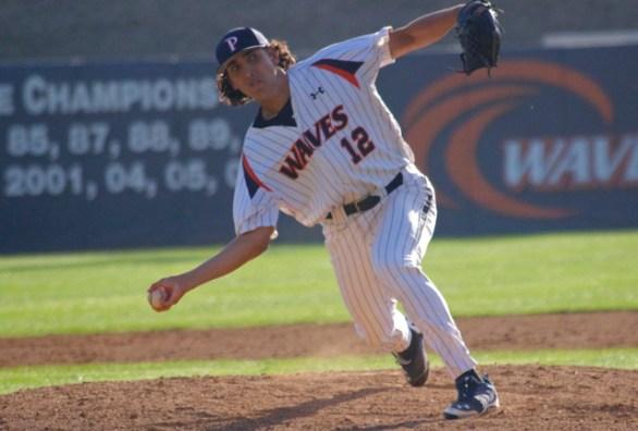Evan Dunn flips a pitch.