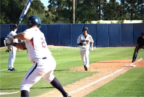 Matt Gelalich leads off third base with the winning run.