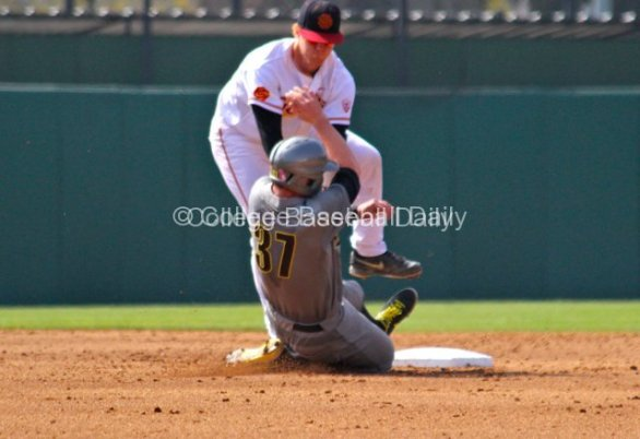 Adam Landecker jumps out of the way of the sliding runner.