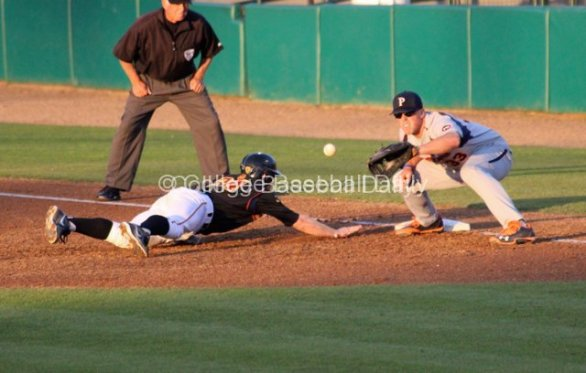 Sam Meyer catches the throw over as Kevin Swick dives back.