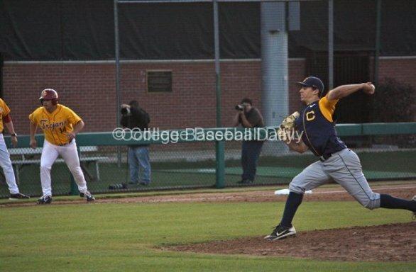 Theofanopoulas pitches with Brandon Garcia on third base.