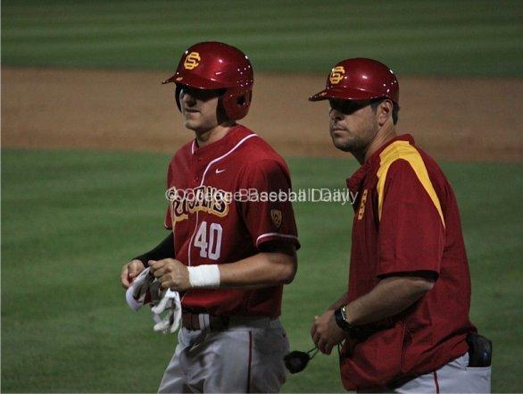 Alex Sherrod and first base coach Eric Munson